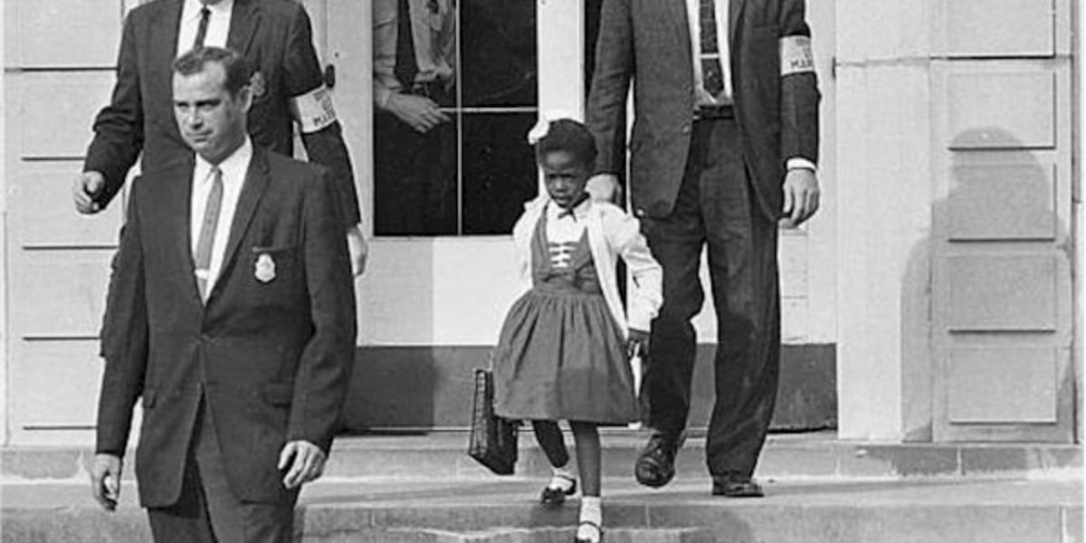 ruby_bridges_escorted_by_us_marshalls_photo_department_of_justice_wikimedia_commonsjpg.jpg